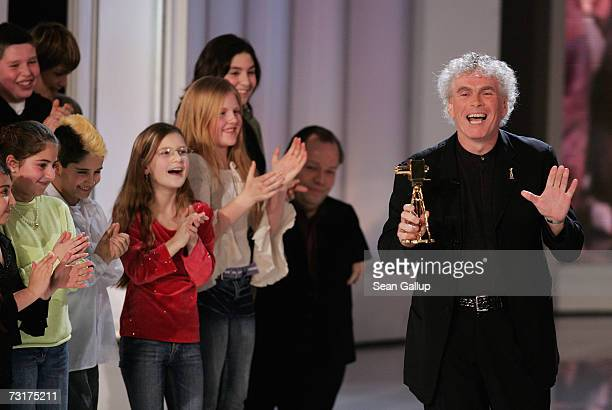 Sir Simon Rattle holds his Special Integration Award at the 42nd Goldene Kamera Awards February 1 2007 in Berlin Germany