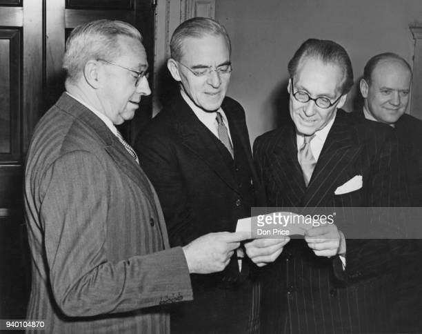 Sir Stafford Cripps receives a cheque for £8000 from Norman Mighell Acting High Commissioner for Australia at the Treasury in London 16th November...