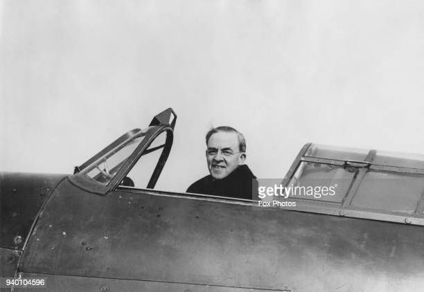 Sir Stafford Cripps the Minister of Aircraft Production in the cockpit of an aircraft circa 1943