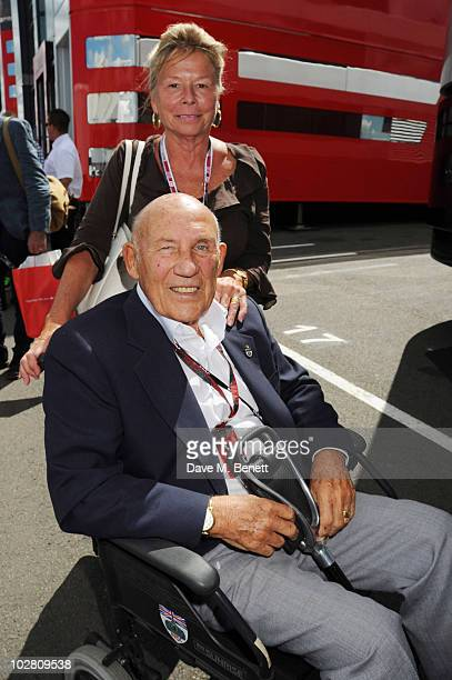 Sir Stirling and Lady Susie Moss visit the F1 paddock during race day ahead of the Formula One British Grand Prix at Silverstone on July 11 2010 in...