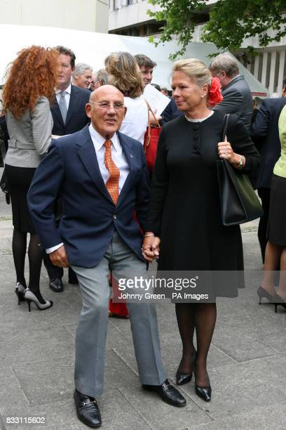 Sir Stirling Moss and his wife Susie attend a service of thanksgiving for the life of Ian Wooldridge the former Daily Mail sports journalist at...