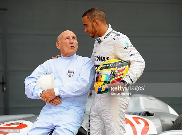 Sir Stirling Moss and Mercedes AMG Petronas F1 driver Lewis Hamilton meet at Silverstone Circuit on May 31 2013 in Northampton England