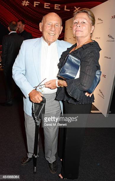 Sir Stirling Moss and wife Susie Moss attend as guests of Jaguar at the global reveal of the new XE in London at Earls Court on September 8 2014 in...
