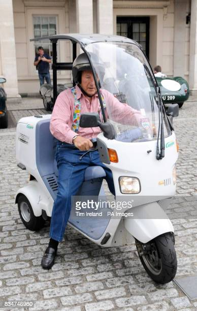 Sir Stirling Moss who leaves the Lanesborough Hotel in London on his threewheeled Canopy scooter after celebrating the 60th anniversary of Jaguar's...