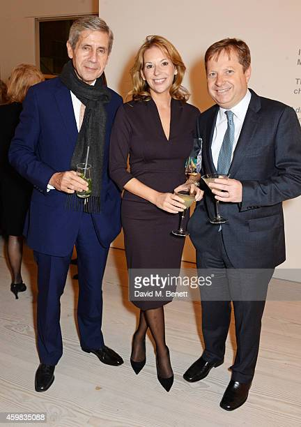 """Sir Stuart Rose, Celia Dunstone and Sir Charles Dunstone attend a private view of """"And The Stars Shine Down"""" by Stasha Palos at the Saatchi Gallery..."""