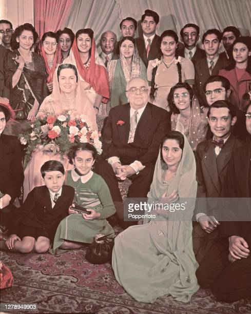 Sir Sultan Mahomed Shah, Aga Khan III posed in centre with his fourth wife Begum Om Habibeh Aga Khan and family members at The Ritz Hotel in London...
