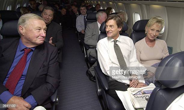 Sir Terence Conran talks to actor Nigel Havers and wife Polly bloomfield as they fly on Concorde 24 October 2003 which had taken off from Heathrow...