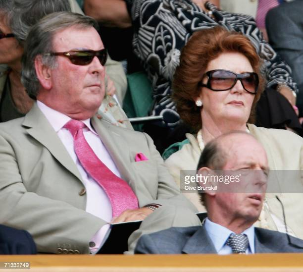 Sir Terry Wogan and his wife Helen sit behind HRH Prince Edward Duke of Kent watching the action on Centre Court during day four of the Wimbledon...