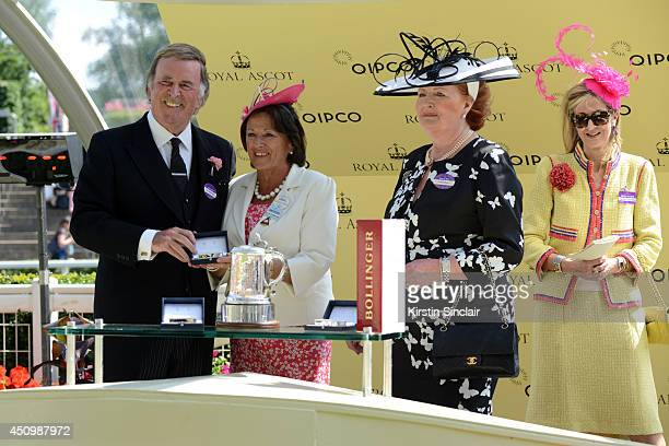 Sir Terry Wogan and Lady Helen Wogan present The Duke of Edinburgh Stakes to owner Laura Weinstock and fellow owner during day five of Royal Ascot at...