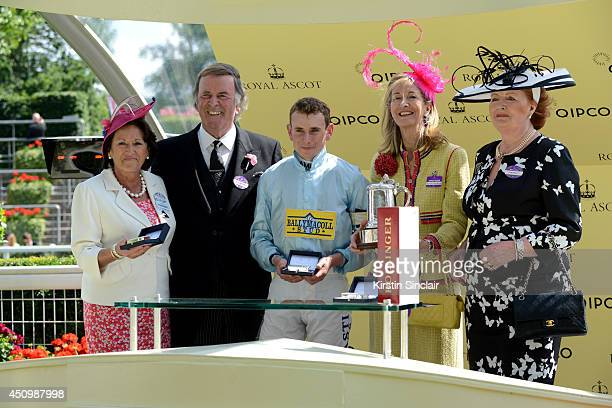 Sir Terry Wogan and Lady Helen Wogan present The Duke of Edinburgh Stakes to jockey Ryan Moore horse owner Laura Weinstock and fellow owner during...