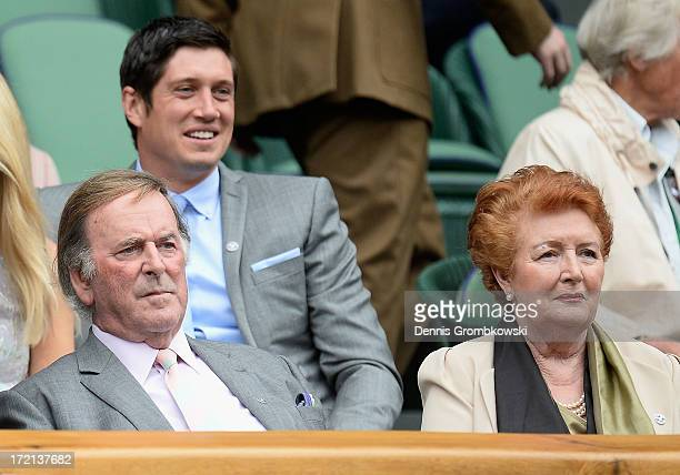 Sir Terry Wogan and Lady Helen Wogan sit in the Royal Box before the Ladies' Singles quarterfinal match between Agnieszka Radwanska of Poland and Na...