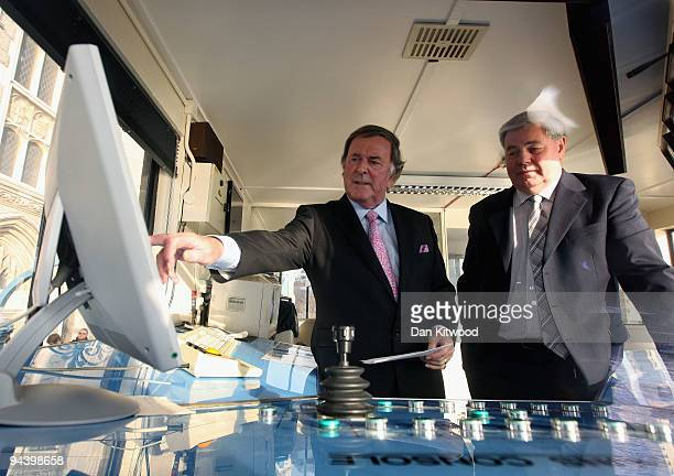 Sir Terry Wogan looks at a computer monitor inside the control tower on Tower Bridge on December 14 2009 in London England Sir Terry was invited to...
