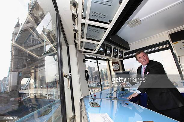 Sir Terry Wogan operates the controls inside the control tower on Tower Bridge on December 14 2009 in London England Sir Terry was invited to raise...