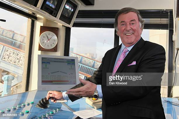 Sir Terry Wogan poses for a picture inside the control tower on Tower Bridge on December 14 2009 in London England Sir Terry was invited to raise the...