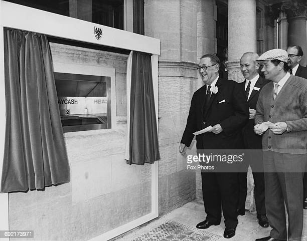 Sir Thomas Bland Deputy Chairman of Barclays Bank unveils the first Barclaycash machine in the London borough of Enfield UK 27th June 1967 Behind him...