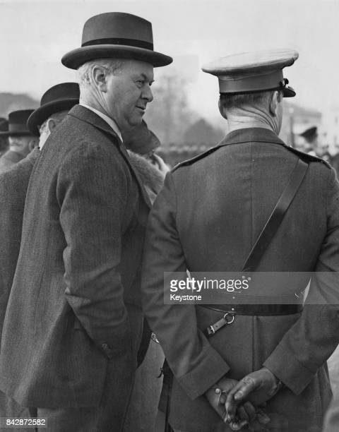 Sir Thomas Inskip, 1st Viscount Caldecote watches a march-past at the Church Parade at Sandhurst College, UK, 4th December 1938. Leslie Hore-Belisha...