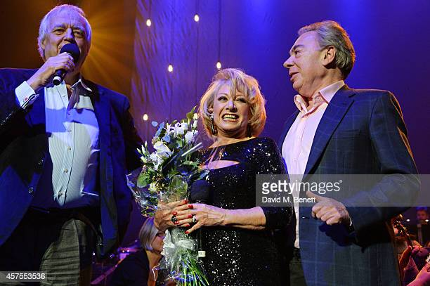 Sir Tim Rice and Lord Andrew Lloyd Webber present Elaine Paige with flowers following her performance of 'Memory' from 'Cats' at her 50th Anniversary...
