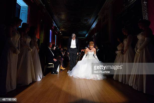 Sir Tobias Clarke and Anna Ermakova are presented during the Queen Charlotte Ball on September 11 2015 in London England Queen Charlotte's Ball is...