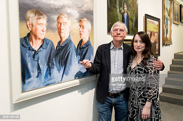 Sir Tom Courtenay and Artist Isobel Peachey pose next to his portrait at the Royal Society of Portrait Painters Photocall at the Mall Galleries on...