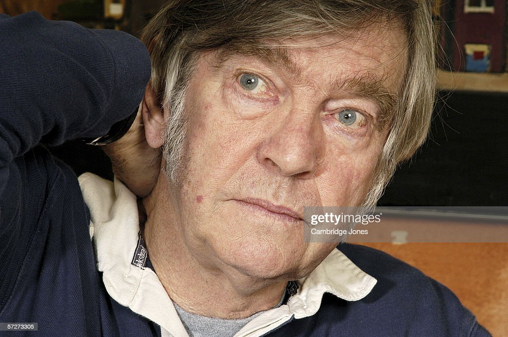 Sir Tom Courtenay poses during a photo call held on May 12, 2005 at home in London.