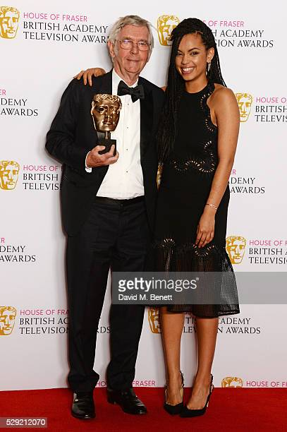 """Sir Tom Courtenay, winner of Best Supporting Actor for """"Unforgotten"""", and presenter Georgina Campbell pose in the winners room at the House Of Fraser..."""