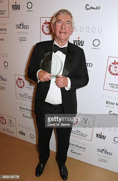 Sir Tom Courtenay winner of the Actor of the Year award for 45 Years poses in front of the Winners Boards at The London Critics' Circle Film Awards...
