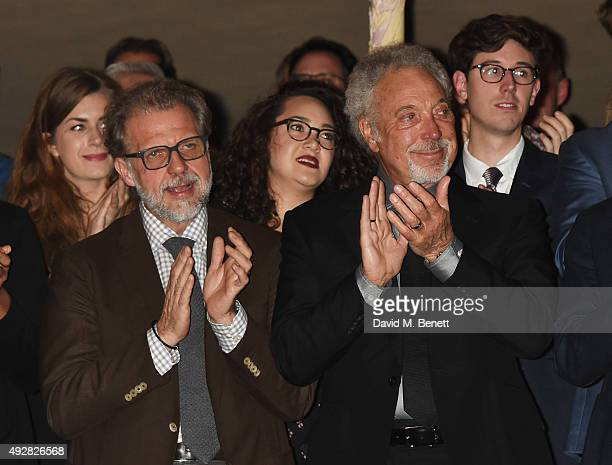 Sir Tom Jones and son Mark Woodward applaud Burt Bacharach at the curtain call during the press night performance of Close To You Bacharach...