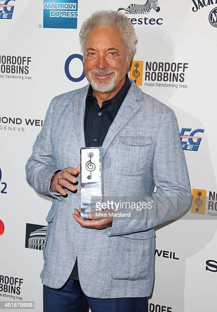 Sir Tom Jones attends the Nordoff Robbins 02 Silver Clef awards at London Hilton on July 4 2014 in London England