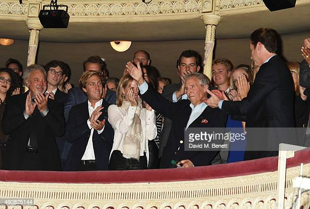 Sir Tom Jones Oliver Bacharach and Jane Hansen applaud Burt Bacharach at the curtain call during the press night performance of Close To You...