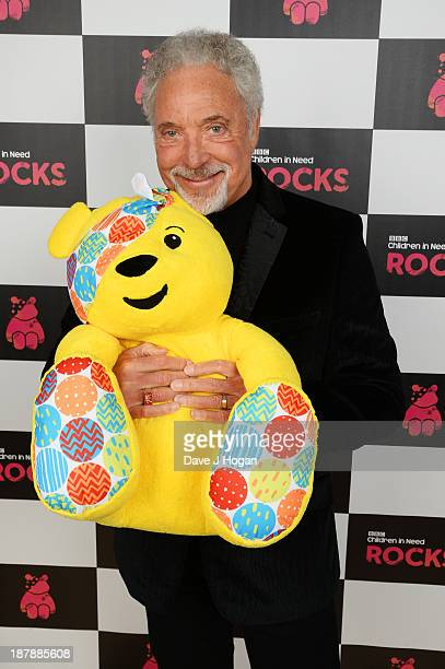 Sir Tom Jones poses backstage with Pudsey Bear during the 'BBC Children In Need Rocks' at Hammersmith Eventim on November 13 2013 in London England...