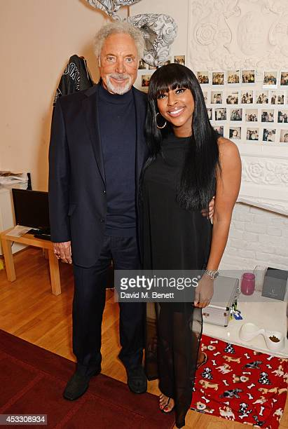 Sir Tom Jones poses with Alexandra Burke backstage at the West End production of 'The Bodyguard' at the Adelphi Theatre on August 7 2014 in London...