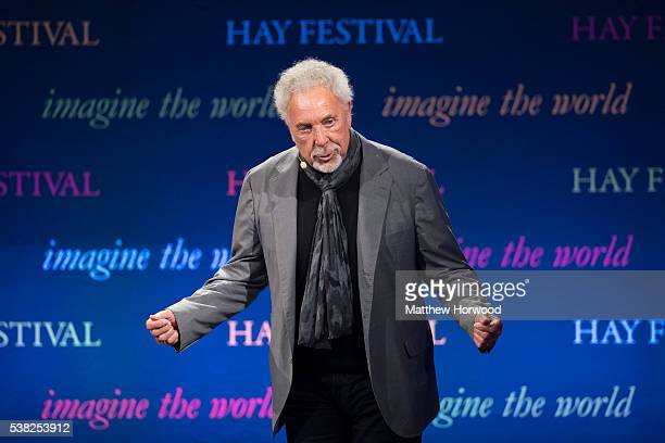 Sir Tom Jones takes a bow as he walks on stage during the 2016 Hay Festival on June 5, 2016 in Hay-on-Wye, Wales. This is the Welsh singer's first...