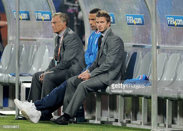 Sir Trevor Brooking Rio Ferdinand and David Beckham of England sit on the bench prior to the 2010 FIFA World Cup South Africa Group C match between...