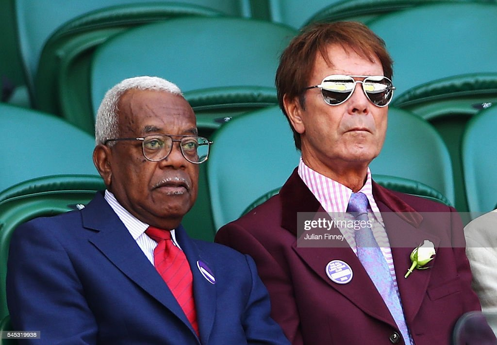 Sir Trevor McDonald and Sir Cliff Richard look on from Centre Court during the Ladies Singles Semi Final match match between Serena Williams of The United States and Elena Vesnina of Russia on day ten of the Wimbledon Lawn Tennis Championships at the All England Lawn Tennis and Croquet Club on July 7, 2016 in London, England.