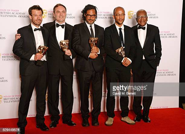 Sir Trevor McDonald poses with David Olusoga and fellow winners of the Specialist Factual award for Britain's Forgotten Slave Owners in the winners...