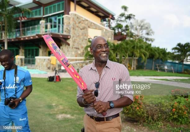 Sir Vivian Richards looks on as he holds a Tournament branded bat during a West Indies Net Session at Coolidge Cricket Ground on November 20, 2018 in...
