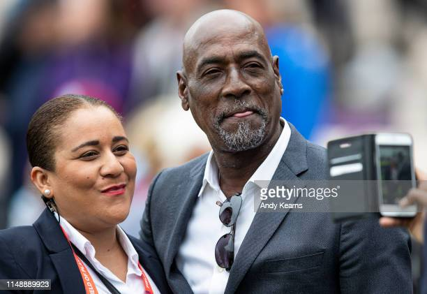 Sir Vivian Richards poses for a fan picture during the Group Stage match of the ICC Cricket World Cup 2019 between South Africa and West Indies at...