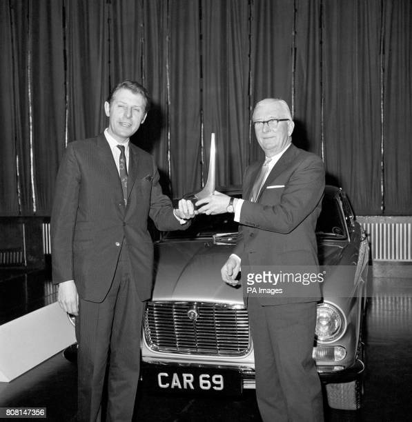 Sir William Lyons , chairman of Jaguar, receives 'Car' magazines Car of the Year Award from the Minister of Transport, Richard Marsh for the Jaguar...