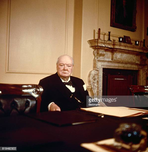 Sir Winston Churchill Britain's Prime Minister seated at his desk on his 80th birthday