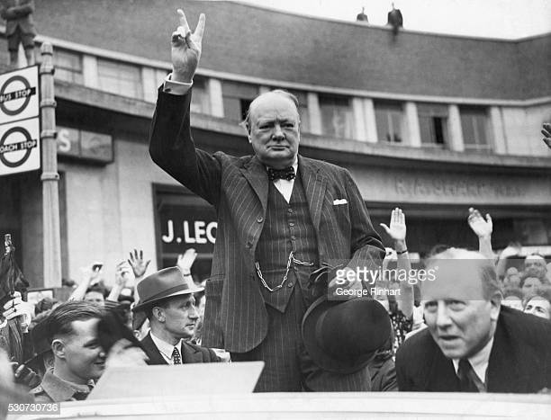 Sir Winston Churchill campaigning for reelection to the Prime Minister's seat gives the 'V' victory sign to people during a rally at Uxbridge