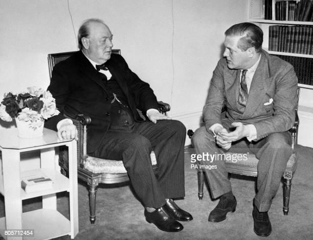 Sir Winston Churchill chats with his son Randolph Churchill