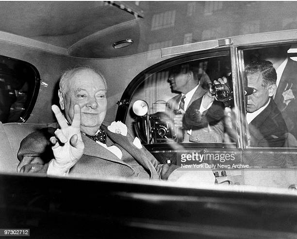 Sir Winston Churchill flashes 'V' for victory sign