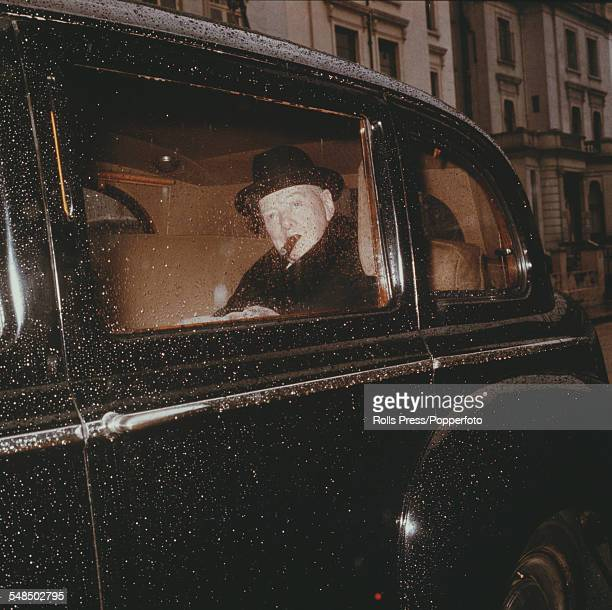 Sir Winston Churchill leaves his London residence at 28 Hyde Park Gate by car to attend a session at the House of Commons in Westminster London in...