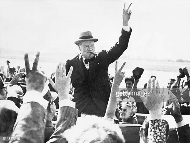 Sir Winston Churchill makes the Victory Sign as he greets wellwishers from his automobile Photograph