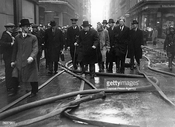 Sir Winston Leonard Spencer Churchill British politician touring the blitz damaged streets in the City of London He is accompanied by his wife and...
