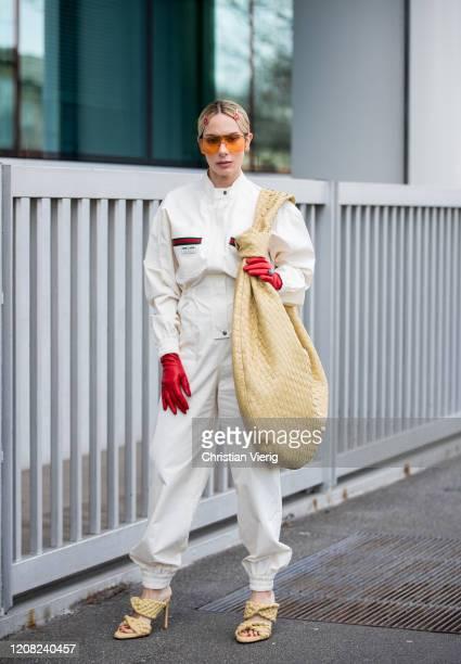 Sira Pevida is seen wearing beige oversized Bottega Veneta bag sandals Gucci overall sunglasses red gloves Prada hair clip outside Boss during Milan...