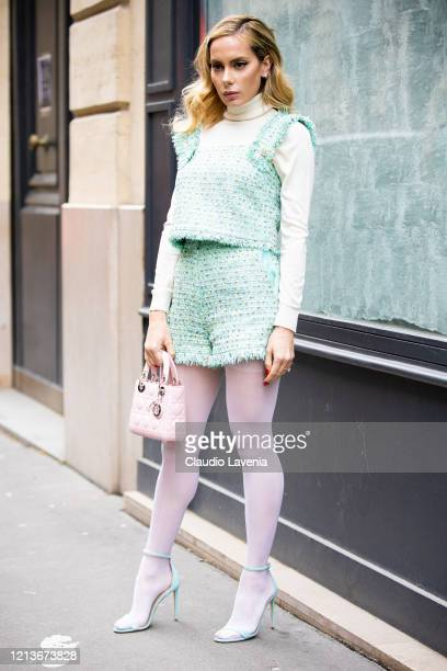 Sira Pevida, wearing a cream turtleneck top, teal top with matching shorts, white tights, teal sandals and pink Dior bag, is seen outside Ralph &...