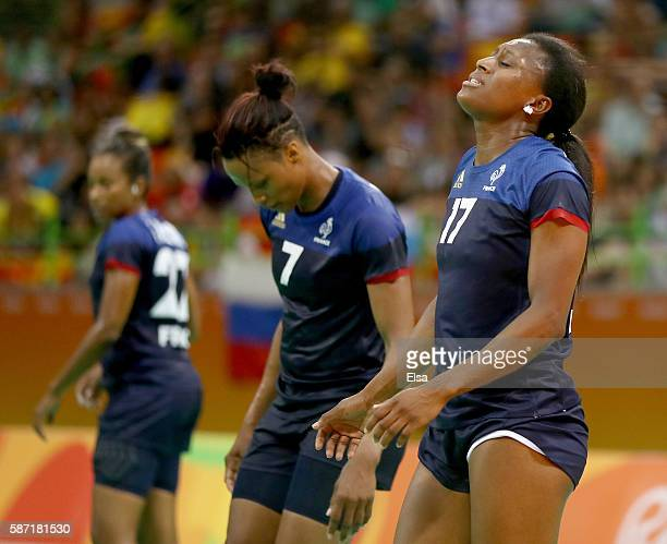 Siraba Dembele Allison Pineau and Estelle NzeMinko of France react in the second half against Russia on Day 3 of the Rio 2016 Olympic Games at the...