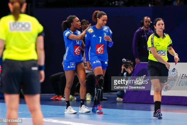 Siraba Dembele is trying to cheer up Allison Pineau of France for being ejected from the EHF Women's Euro 2018 Final match between Russia and France...