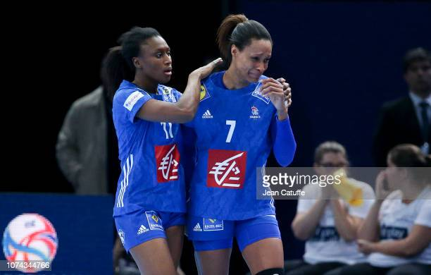 Siraba Dembele Pavlovic of France consoles Allison Pineau of France who received a red card during the EHF Women's Euro 2018 Final match between...